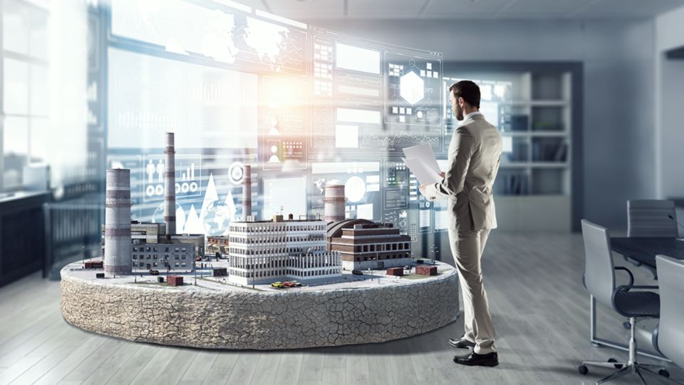 man in front of a digital twin of a building