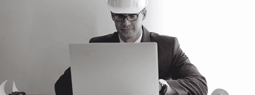 Man in front of a laptop